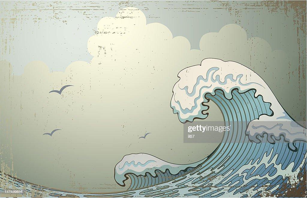 Crashing wave with birds flying overhead