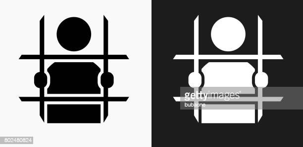criminal behind bars icon on black and white vector backgrounds - arrest stock illustrations, clip art, cartoons, & icons