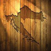 Croatia Map on lit Wooden Background