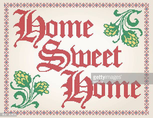 cross stitched home sweet home decoration with border design - home sweet home stock illustrations