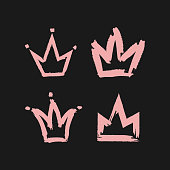 Crown painted with a rough brush. Four pink icons isolated on black background.