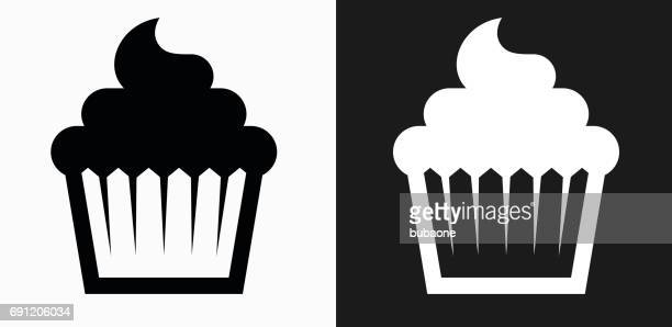 cupcake icon on black and white vector backgrounds - muffin stock illustrations, clip art, cartoons, & icons