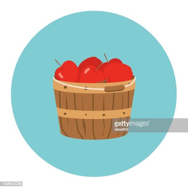 cute autumn icon - bushel basket of apples - basket stock illustrations, clip art, cartoons, & icons
