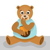 Cute bear eating honey