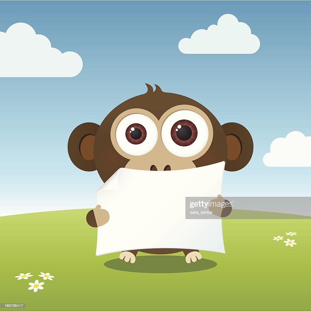 Cute big-eyed monkey holding a blank paper