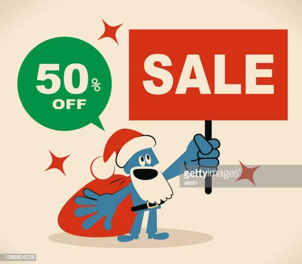 Cute blue Santa Claus holding Sale Sign