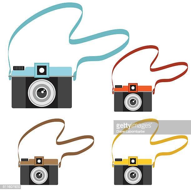 cute cartoon retro cameras with straps - strap stock illustrations