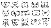 Cute cat heads in hand drawn style. Vector illustration