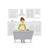 cute cheerful woman cooking in the kitchen, preparing food