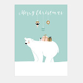 Cute Christmas greeting card. Polar bear and gift boxes. Vector.