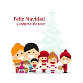 Cute family singing carols at Christmas Night with tree background. Spanish title