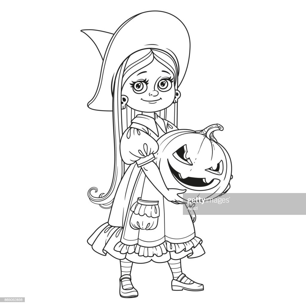 Cute girl in witch costume holding a large pumpkin carved with a