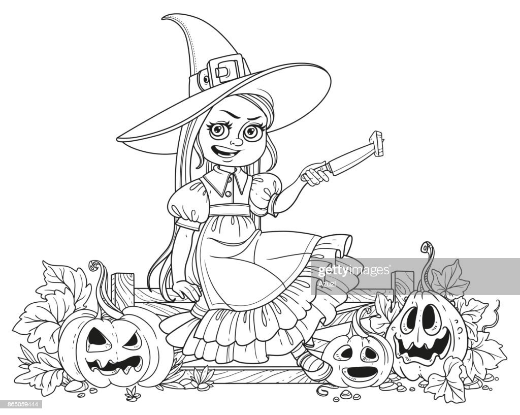 Cute girl in witch costume sitting on the fence with a knife and