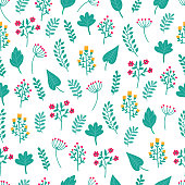 Cute hand drawn floral colorful seamless pattern of flowers and green plants on white background. Perfect for scrapbooking, wrapping paper, textile etc.