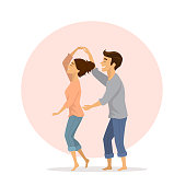 cute happy romantic couple in love having fun dancing  at home