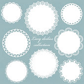 Cute lacy doilies set on floral background.