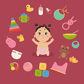 Cute little baby in diaper with newborn essentials