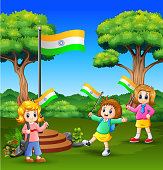 Cute little kids holding national flag and enjoying on nature background