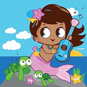 Cute mermaid by the sea playing music with her guitar