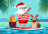 Cute Santa Claus on stand up paddle board with pug dog and gifts against tropical ocean background vector cartoon illustration. Christmas in July, pets, summer, vacation, resort, warm climate theme