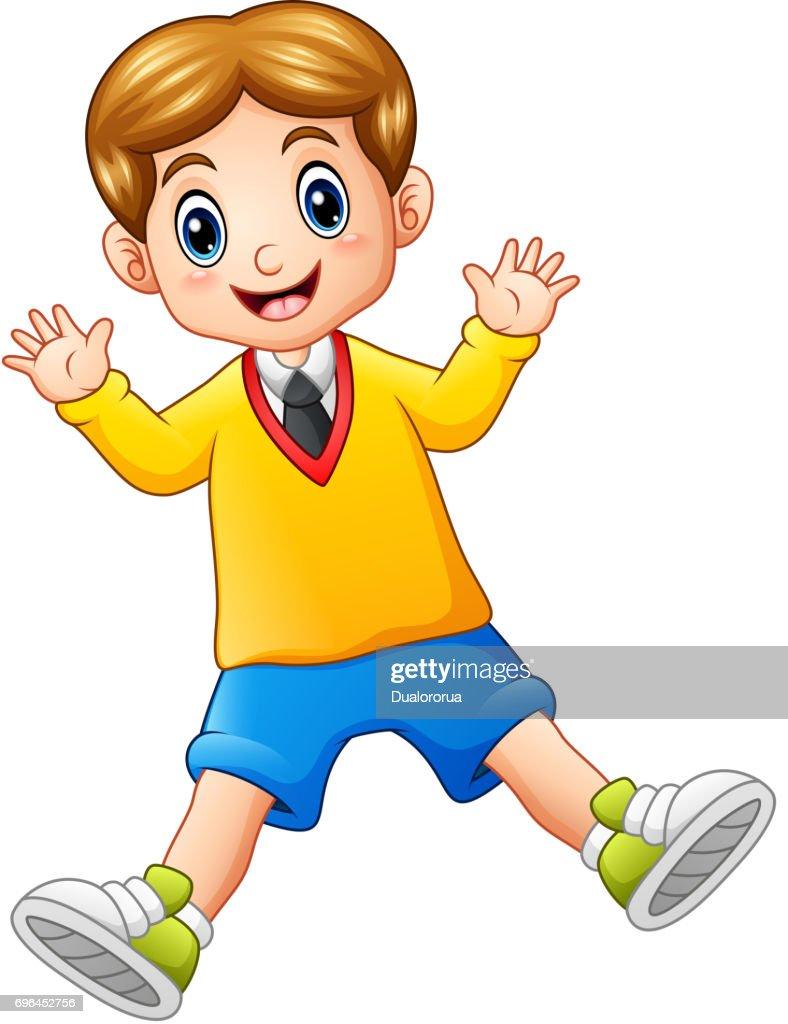 A cute schoolboy waving hands