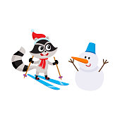 Cute skiing raccoon character and funny snowman