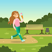 Cute smiling girl eating ice cream while walking in city park, kids outdoor activity vector illustration