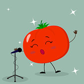 Cute tomato smiley in a cartoon style sings into the microphone.