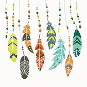 Cute vector set of vintage ethnic feathers in pastel colors