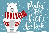 "Cute winter card with hand drawn bear and lettering ""Baby, it's cold outside"""