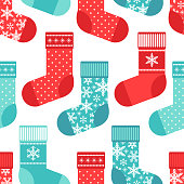 Cute winter seamless pattern with socks in traditional colors
