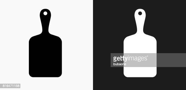 Cutting Board Icon on Black and White Vector Backgrounds