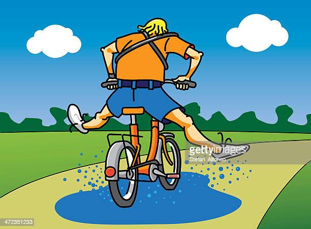 Cycliste traverser une flaque