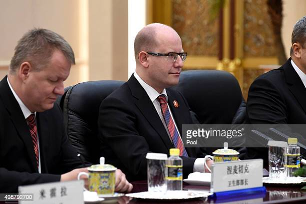 Czech Prime Minister Bohuslav Sobotka listens as he meets with Chinese President Xi Jinping during a bilateral meeting after he attended the 4th...