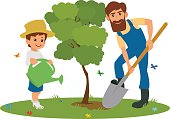 Dad and son planting trees