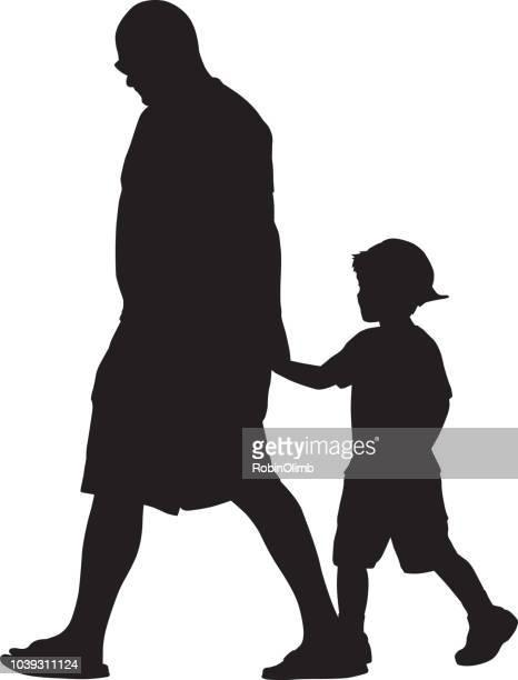 Papá camina con silueta de hijo