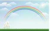 Daisy and rainbow against blue sky