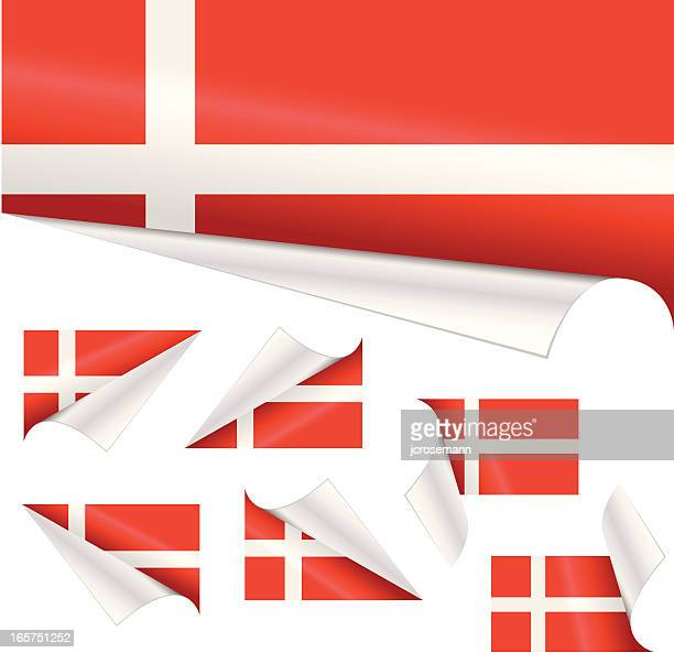 Danish Flags behind Curled Paper