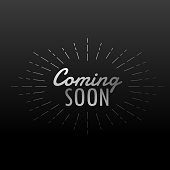 dark background with coming soon text with line rays