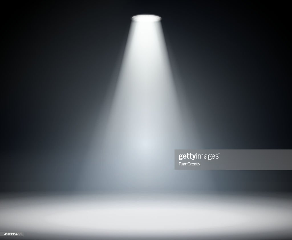 Dark background with spotlight.