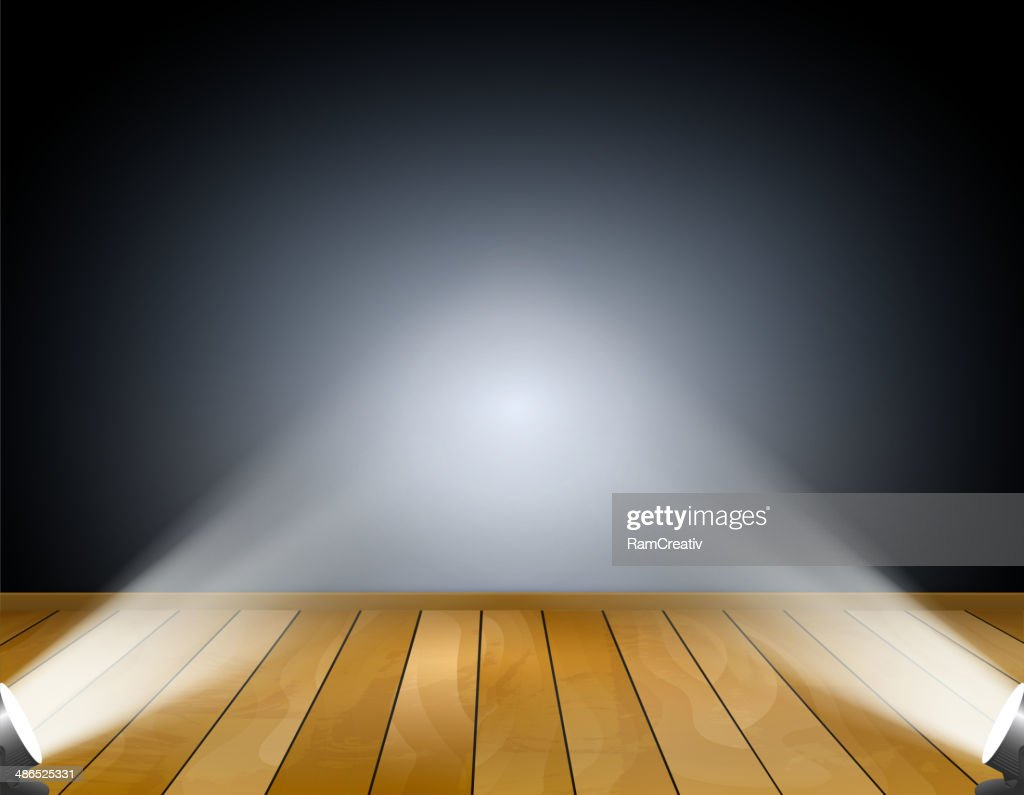 Dark background with spotlights or projection lamps. Studio with wooden floor