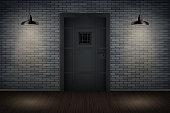Dark brick wall and prison or loft interior