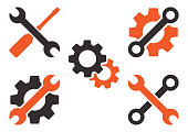 Dark gray and orange set of tools icon. Vector illustration