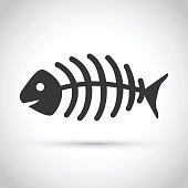 A dead fish on a gray background