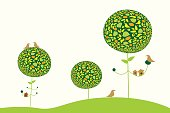 Decorated spring trees with birds and nesting box