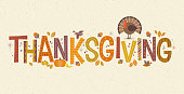 Decorative lettering Thanksgiving with seasonal design elements and turkey.