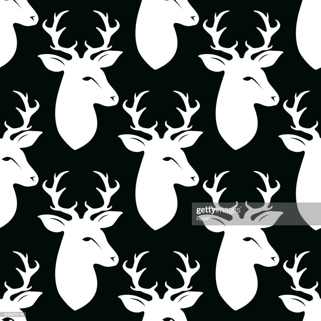 Deer head with horns. Seamless vector pattern