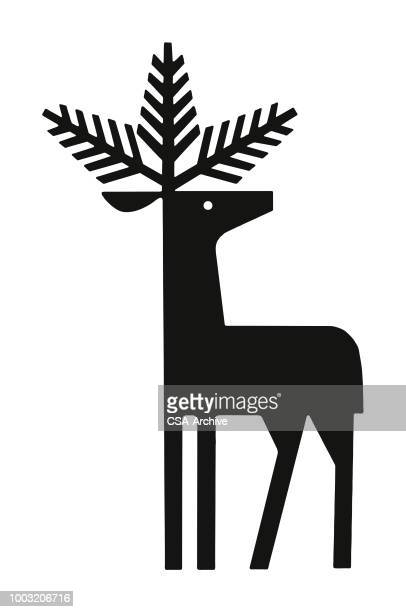 deer with evergreen branches for antlers - stag stock illustrations