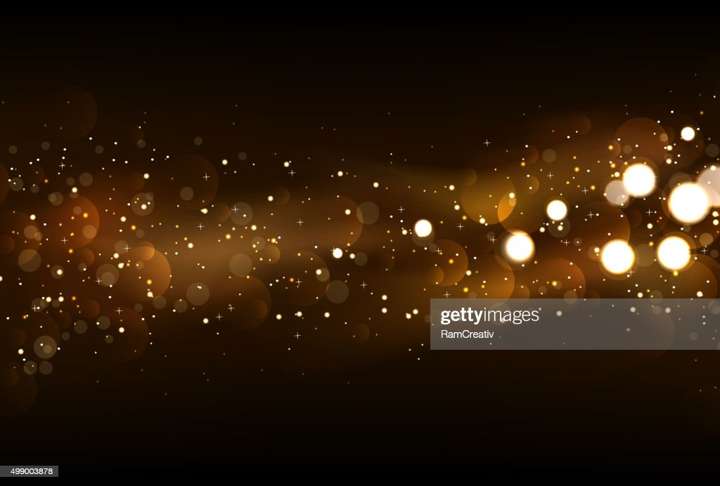 Defocused glitter lights background in dark gold and black color