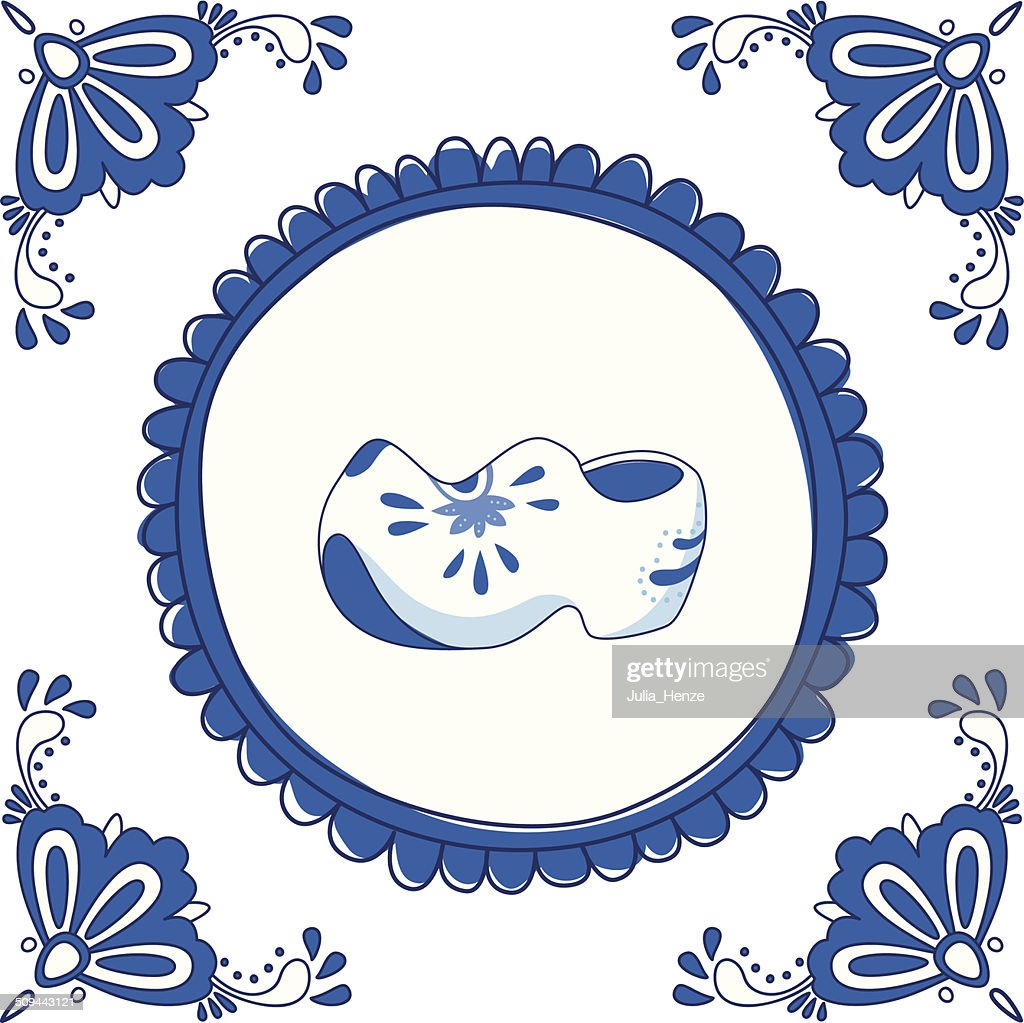 Delft blue tile with a pair of clogs